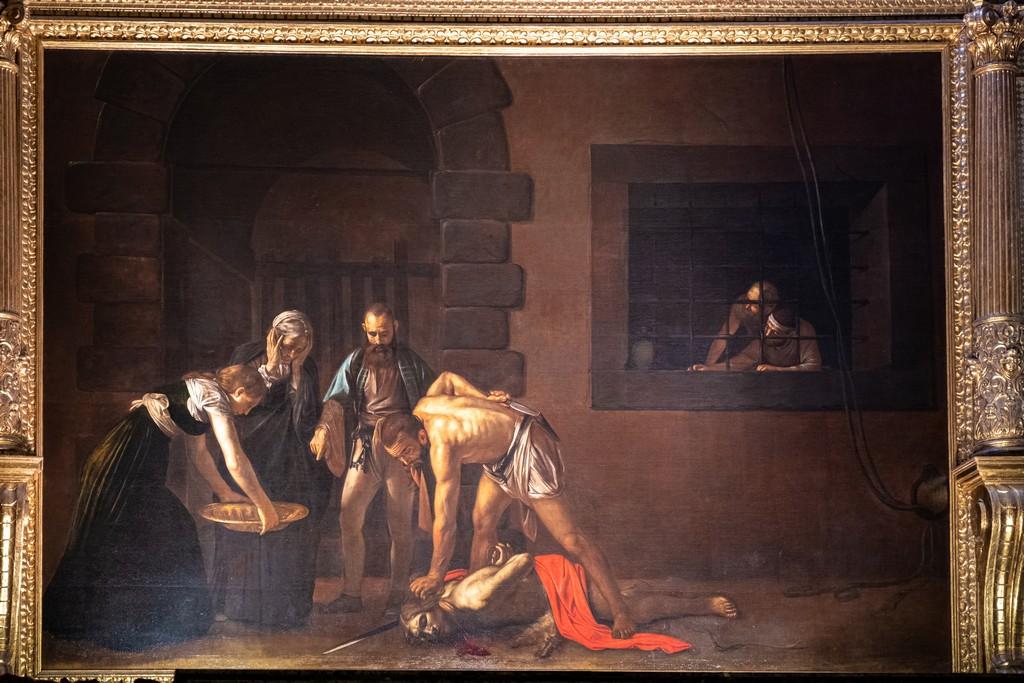 Guida alla Co-Cattedrale di San Giovanni dipinto di Caravaggio