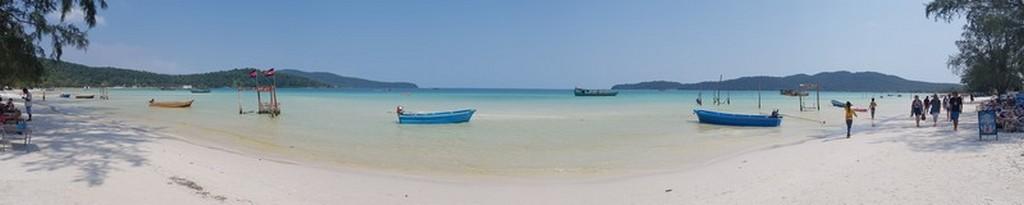Guida a Koh Rong Samloem spiaggia con barche
