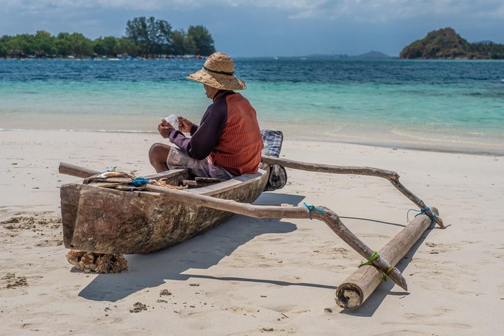 pescatore sulla sua barca